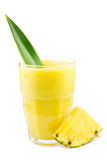 Pineapple smoothie. Glass of fresh pineapple smoothie decorated with a pineapple leaf and a piece of pineapple Stock Images