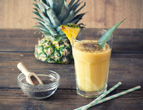Pineapple smoothie. With chia seed on wooden table Royalty Free Stock Photography