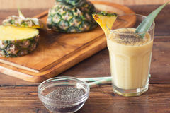 Pineapple smoothie. With chia seed on wooden table Royalty Free Stock Photos