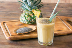 Pineapple smoothie. With chia seed on wooden table Stock Image