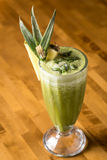 Pineapple smoothie in glass. On bar counter Stock Photo