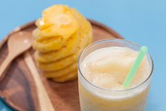 Pineapple smoothie in glass. Close up of pineapple smoothie in glass Stock Photos