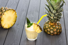 Pineapple Smoothie with Mint and a Piece of Pineapple, Dark Background. Horizontal Royalty Free Stock Photography