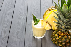 Pineapple Smoothie with Mint and a Piece of Pineapple, Dark Background. Horizontal Stock Images
