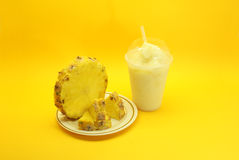 Pineapple Smoothie. Served in plastic cup and straw stock photography