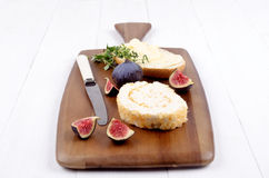 Pineapple soft cheese and bread on wooden board Stock Images