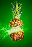 Pineapple splashed with water Stock Images