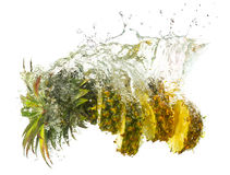 Pineapple splashes Stock Photos