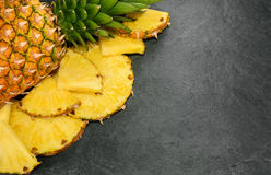 Pineapple on stone background with copy space Royalty Free Stock Image