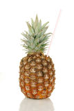 A pineapple with a straw in it Stock Image