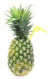 Pineapple with a straw. Isolated pineapple with a straw stock photo