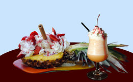 Pineapple with strawberries and ice cream. And a fruit smoothie still life Stock Images