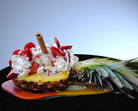 Pineapple with strawberries and ice cream. Still life Stock Photography