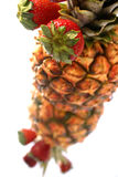 Pineapple and Strawberry. Display royalty free stock photography