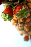 Pineapple Strawberry Display. Hotel display piecewith pineapple and strawberries Royalty Free Stock Images