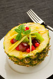 Pineapple stuffed with fruits Royalty Free Stock Photo