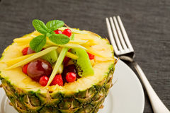 Pineapple stuffed with fruits Stock Photography