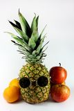 Pineapple with Sunglasses and fruit Stock Photography