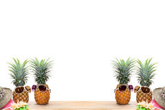 Pineapple with sunglasses and hat beach on wood,concept summer b. Ackground royalty free stock images