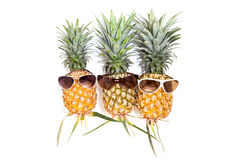 Pineapple with sunglasses on white background. Royalty Free Stock Photography
