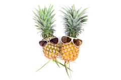 pineapple with sunglasses on white background. Stock Photo