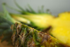 Pineapple on a table. Cut in half in focus Royalty Free Stock Images