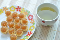 Pineapple Tarts and a Cup of Green Tea stock photography