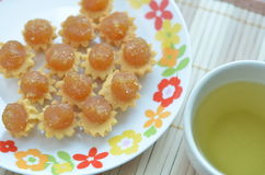 Pineapple Tarts and a Cup of Green Tea royalty free stock images