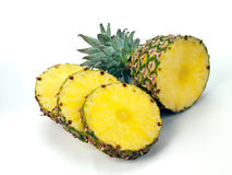 Pineapple top and slices on white Stock Image