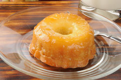 Pineapple upside down cake. A mini pineapple upside down cake with a glass of milk Stock Photo