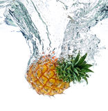 Pineapple in water. A pineapple splashing into water stock image