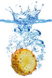 Pineapple in water Stock Photos