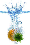 Pineapple in water. A pineapple splashing into water Royalty Free Stock Images