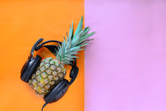 Pineapple wearing headphones. Cute summer party concept Stock Photography