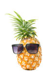 Pineapple wearing sunglasses - Summertime vacation holiday eatin Stock Images