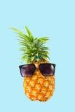 Pineapple wearing sunglasses - Summertime vacation holiday eatin Stock Photo