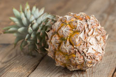 Pineapple on wood background. Selective focus. Stock Photo