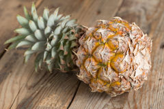 Pineapple on wood background. Selective focus. Stock Photography