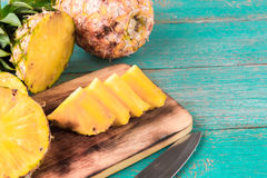 Pineapple on the wood texture background Royalty Free Stock Images