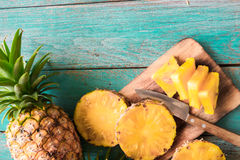 Pineapple on the wood texture background Royalty Free Stock Photography