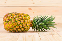 Pineapple on the wooden background Royalty Free Stock Photo