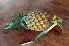 Pineapple on wooden background detail Royalty Free Stock Photo