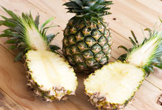 Pineapple on a wooden background. Pineapple fresh ann green is on a wooden background Stock Image