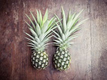 Pineapple on wooden background Royalty Free Stock Image