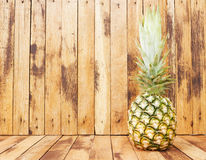 Pineapple on wooden background. Retro style. Royalty Free Stock Photo