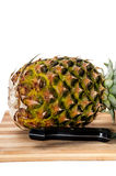 Pineapple on a wooden board with knife Stock Image
