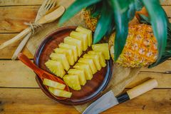 Pineapple on the wooden stock photos
