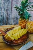 Pineapple on the wooden stock photography