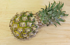 Pineapple, yellow, raw, eat, fruit. Pineapple on the wooden background Stock Photography