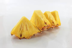 Pineapple. Yellow resting on a white background Royalty Free Stock Photo